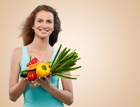 Woman_Holding_Healthy_Veggies.jpg